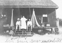 Sam Woodring, Leana, and George Underhill on the Porch of the Woodring House