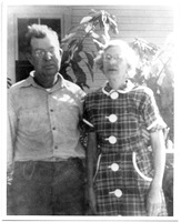 Clarence and Ruth Rutland Outside their Home