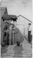 Men Unload A Trunk On The Dock of Sanibel's Main Landing.