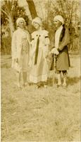 Claude, Imogene, and Laurie in 19th century costumes