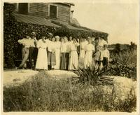 Group photo in front of house
